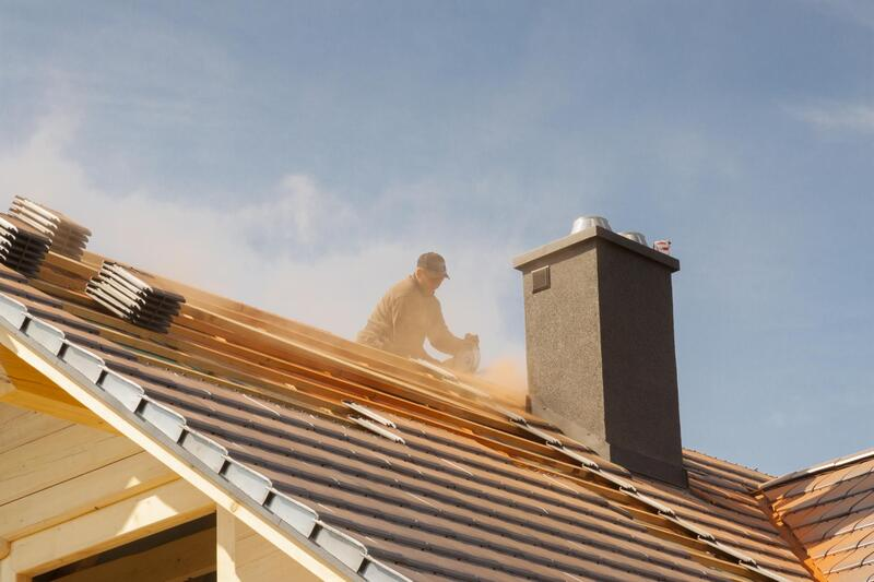 professional roofer working on roof repair